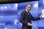 European Council President Donald Tusk holds a letter signed by UK Prime Minister Theresa May starting the clock on Brexit (AP Photo/Olivier Matthys)