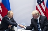 US President Donald Trump shakes hands with Russian President Vladimir Putin during the G20 summit in Hamburg Germany, Friday July 7, 2017. (AP Photo/Marcellus Stein)