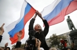 Demonstrators shout slogans and wave Russian flags during an opposition rally in Moscow, Russia on Oct. 7, 2017. (AP Photo/Alexander Zemlianichenko)