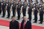 US President Donald Trump walks with Chinese President Xi Jinping during a welcome ceremony at the Great Hall of the people in Beijing. (AP Photo/Andy Wong)