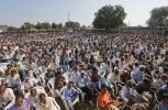 People listen to Congress party Vice President Rahul Gandhi during an election rally near Bayad in Gujarat state's Aravalli district, India. (AP Photo/Ajit Solanki)