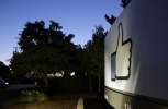 "The Facebook ""like"" symbol is illuminated on a sign outside the company's headquarters in California. (AP Photo/Marcio Jose Sanchez)"
