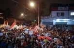 Supporters of Brazil's former President Luiz Inacio Lula da Silva gather to protest the arrest warrant which may keep the popular leader off Brazil's October ballot. (AP Photo/Andre Penner)