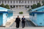 North Korean leader Kim Jong Un and South Korean President Moon Jae-in walking together at the Panmunjom in the Demilitarized Zone on April 27, 2018. (Korea Summit Press Pool via AP)