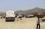World Food Programme (WFP) aid arrives in in Aslam, Hajjah, Yemen. The programme recently accused the government of redirecting aid to fund the war and insisted that aid recipients participate in a biometric identity-tracking system, sparking a data governance standoff. (AP Photo/Hammadi Issa)