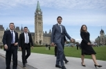 Prime Minister Justin Trudeau and Minister of Foreign Affairs Chrystia Freeland walk to a press conference on the USMCA trade deal