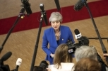 British Prime Minister Theresa May speaks with the media as she arrives for an EU summit at the Europa building in Brussels on April 10, 2019. (AP Photo/Francisco Seco)