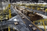 , packages ride on a conveyor system at an Amazon fulfillment center in Baltimore. (AP Photo/Patrick Semansky, File)