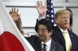 US President Donald Trump and Japan's Prime Minister Shinzo Abe wave after delivering a speech to Japanese and US troops on May 28, 2019. (Athit Perawongmetha/Pool Photo vi AP)
