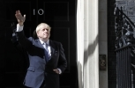 Britain's new Prime Minister Boris Johnson waves from the steps outside 10 Downing Street on July 24, 2019. (AP Photo/Frank Augstein)