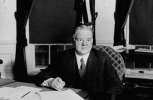 President Herbert Hoover signs unemployment and drought relief bills during the Great Depression. Dec. 20, 1930. (AP Photo)