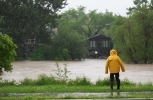 Resident looks on as the Elbow River overflows its banks flooding homes in low-lying areas.