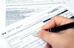 Filling out a Canadian T1 tax form. (Shutterstock)