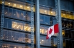 Canadian flag in front of a business building in Toronto, Ontario, Canada (Shutterstock)
