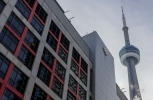 The CN Tower looms over the Canadian Broadcasting Corporation building in downtown Toronto. (Shutterstock)