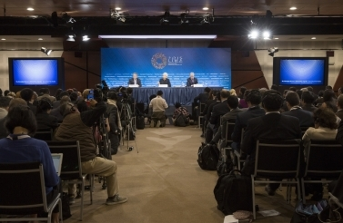 Photo of three people speaking at IMF panel