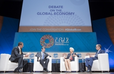 Photo of four people speaking at IMF panel