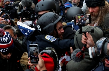 Pro-Trump protesters clash with police during a rally to contest the certification of the 2020 US presidential election results on January 6, 2021. (Reuters/Shannon Stapleton)