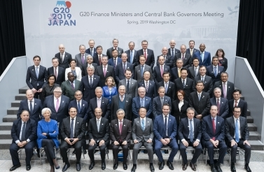 The G20 Finance Ministers and Central Bank Governors pose for a formal family photo at IMF Headquarters during the 2019 IMF/World Bank Spring Meetings April 12, 2019. (IMF Staff Photograph/Stephen Jaffe)