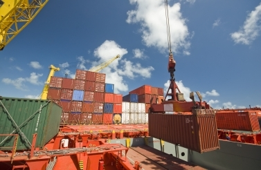 Cargo Containers Being Unloaded - Stock Image