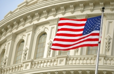 Stock Image - Flag Over US Capitol Building