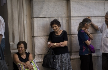 People wait to be allowed into the national bank of Greece (AP Photo/Emilio Morenatti)