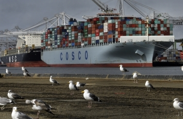 Chinese container ship Cosco Glory waits to be unloaded at the Port of Oakland in Oakland, CA. (AP Photo/Ben Margot, File)
