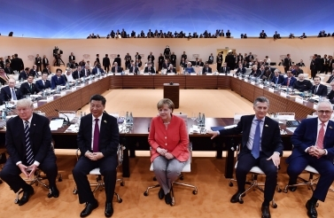 US President Donald Trump, China's President Xi Jinping, German Chancellor Angela Merkel, Argentina's President Mauricio Macri and Australia's Prime Minister Malcolm Turnbull turn around for photographers at the start of the first working session of the 2017 G20 meeting in Hamburg. (John MacDougall/Pool Photo via AP)