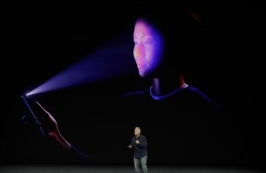 Phil Schiller, Apple's senior vice president of worldwide marketing announces the iPhone X facial recognition feature at the September 2017 showcase. (AP Photo/Marcio Jose Sanchez)