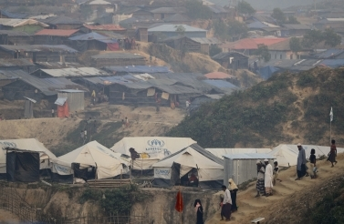 Rohingya Muslim men and women walk through Kutupalong refugee camp in Bangladesh. (AP Photo/Wong Maye-E)