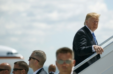 President Donald Trump leaves the G7 summit in Charlevoix, Quebec early for a trip to Singapore to meet with North Korean leader Kim Jong Un. (AP Photo/Evan Vucci)