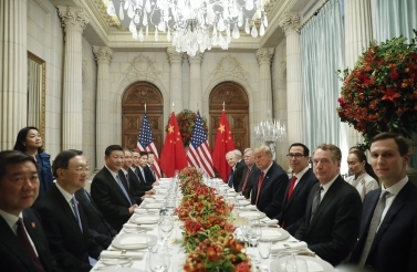 US President Donald Trump with China's President Xi Jinping and members of their official delegations during their bilateral meeting at the G20 Summit, December 1, 2018 in Buenos Aires, Argentina. (AP Photo/Pablo Martinez Monsivais)