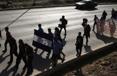 On December 11, 2018, Honduran migrants marched to the US consulate in Tijuana, Mexico, calling for authorities to speed up the asylum application process. (AP Photo/Moises Castillo)