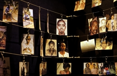 Family photographs of some of those who died hang on display in an exhibition at the Kigali Genocide Memorial centre in the capital Kigali, Rwanda Friday, April 5, 2019. (AP Photo/Ben Curtis)