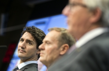 Canadian Prime Minister Justin Trudeau participates in a media conference with European Council President Donald Tusk during an EU-Canada summit at the European Council. (AP Photo/Thierry Monasse)
