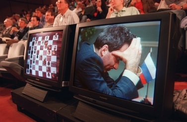In this May 1997 photo, spectators watch world chess champion Garry Kasparov famously play against IBM's Deep Blue chess playing computer. (AP Photo/Kathy Willens)