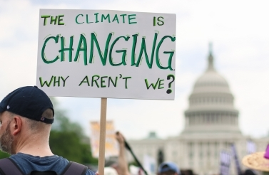 Nicole S Glass / Shutterstock.com | Washington, DC - April 29, 2017: Thousands of people attend the People's Climate March to stand up against climate change.