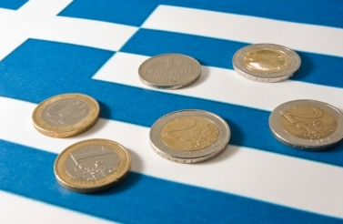 coins on Greek flag