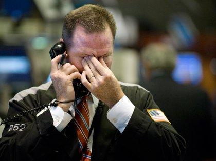 Broker with hand on face (The Associated Press).jpg