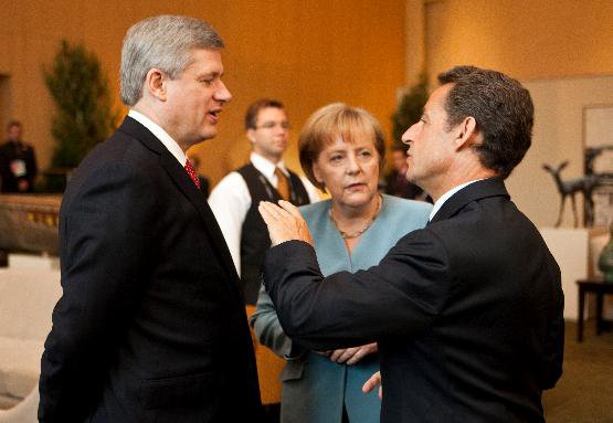 Prime Minister Stephen Harper chats with Angela Merkel, Chancellor of Germany, and Nicolas Sarkozy, President of France at the G-8.JPG